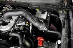 The heat shield and filter are designed to be located in the original air box space