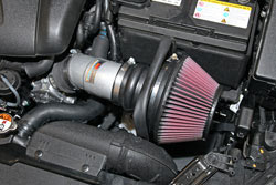 K&N powder coated its short ram intake system for 2014 Kia Forte and Kia Forte Koup 2.0L models in a silver color to protect the tube and look good under the hood