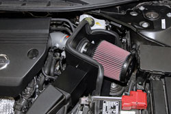The heat shield used in the 2013-2016 Nissan Altima K&N air intake system uses and adaptor to retain the stock air ducting which routes cold air toward the intake