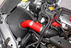 The K&N performance air intake for the 2015-2016 Subaru WRX STi positions the reusable K&N high-flow air filter in a location near the front of the car