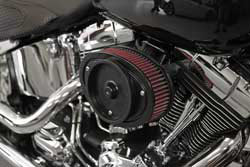 The custom K&N 2013-2015 Softail air cleaner backing provides a solid mounting surface and an integrated crankcase breather system