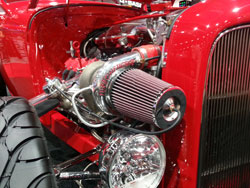 A universal K&N Filter peeking over the headlights on the 1932 Ford during 2012 SEMA Show