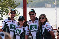 Members of Scott Free Racing take a break before a lake race.