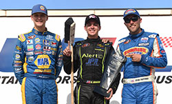 Noah Gragson, Todd Gilliland, and Ryan Partridge on the podium