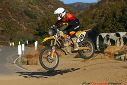 Travis Ginter aboard one of two RM-Z450 motorcycles ridden by Team Malcolm Smith/Norco Tires. Photo courtesy of Sean Renshaw.