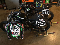 Cory's two bikes and his racing leathers that K&N helped him acquire.