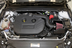 The 2013-2014 Ford Fusion EcoBoost intake air filter is shrouded by an application specific air filter heat shield built to snap onto the factory lower air box housing