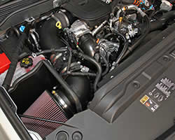Engine bay shot of K&N 57-3077 performance air intake system installed into the Chevy Silverado or GMC Sierra Duramax