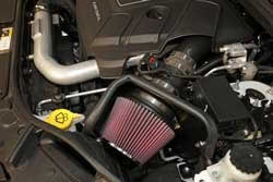 Engine bay shot of K&N Air Intake 63-1570 for the 2014 and 2015 Jeep Grand Cherokee