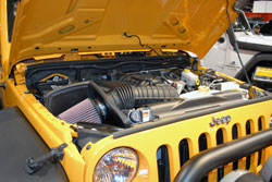 The guys at AEV managed to squeeze a 392ci HEMI V8 and manual transmission into this JK.