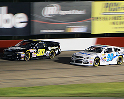 Rico Abreu barely beat Grant Quinlan to the finish line with a decisive pass for the lead on Lap 115