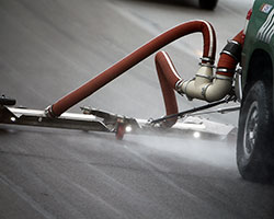 Using compressed air, the NASCAR® Air Titan™ pushes water off of the racing surface and onto the apron where vacuum trucks and Jet dryers will remove the remainder of the moisture