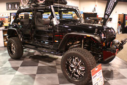 A K&N air filter sits underneath the hood of this 2012 Jeep Wrangler that was dsiplayed at the 2012 SEMA Show