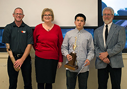 Calvin Ha of Mark Keppel High School accepts the Alhambra Outstanding Student Award, California State Recognition, and a $500 scholarship from K&N