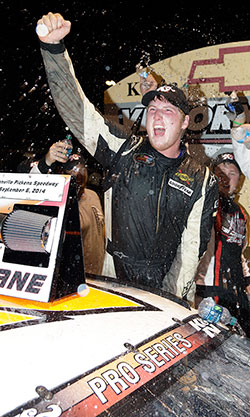 Austin Hill, a NASCAR Next driver, celebrates his first NASCAR K&N Pro Series East win of the 2014 season at Greenville Pickens Speedway giving Hill two NKNPSE career victories