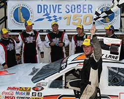 Austin Hill waives the checkered flag as he and the Hill Brothers Racing Team celebrates back to back wins at both Dover International Speedway and the NASCAR K&N Pro Series East