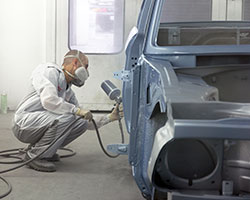 Diamond Hills Collision Center applies a fresh coat of primer to the Clarion Builds 1974 BMW 2002