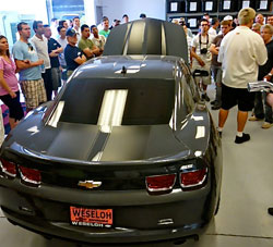 BMW Car Club of America members listen to K&N's Bert Heck explain the design process for K&N air intake systems.