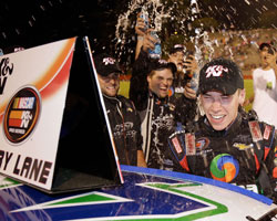 Teammates shower 17-year old Ben Rhodes as they celebrate his third NASCAR K&N Pro Series East win at Bowman Gray Stadium in North Carolina