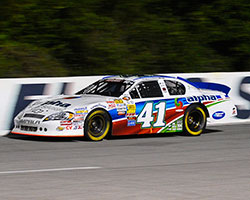 The Alpha Energy Solutions Chevrolet Impala, driven by Ben Rhodes, led 50 laps and won the race at Five Flags Speedway with a .985 second margin over second place