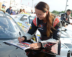 Kenzie Ruston, seen here signing autographs, drove her Ben Kennedy Racing Chevy to a third place finish making her the highest finishing female driver in NASCAR K&N Pro Series East history