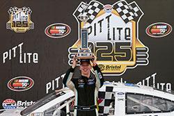 Kyle Benjamin raises the trophy at Bristol Motor Speedway