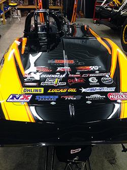 Under the K&N carbon fiber hood scoop is the same Huntsville Engine & Performance 582 cubic inch V8 powerplant