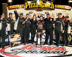 Brandon Jones and his Turner Scott Motorsports pit crew celebrate Jones' first NASCAR K&N Pro Series win in the Autolite Iridium XP 150 at Iowa Speedway