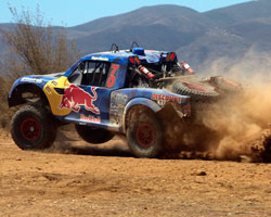 The SCORE-International Baja 500 race is tough on man and machine. The Red Bull Trophy Truck of Menzies Motorsports suffered a flat tire after only 100 miles