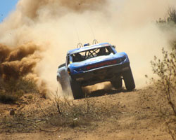 A chase vehicle helped the Red Bull Trophy Truck of Menzies Motorsports get back into the Baja 500 race and regain a lost position