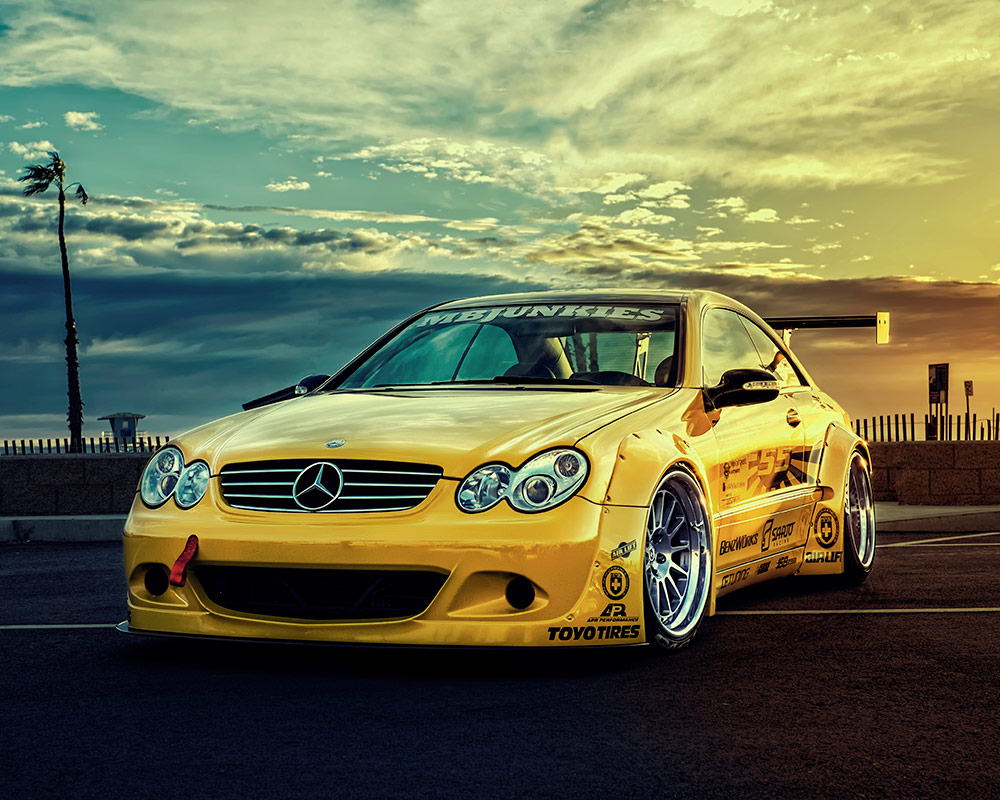 yellow 2005 mercedes clk55 amg pops while on display in nitrofill sema show booth. Black Bedroom Furniture Sets. Home Design Ideas