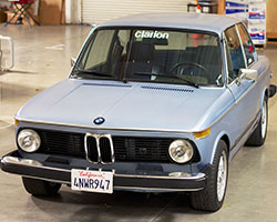 K&N has partnered with the Clarion Builds program and is moving forward with the complete restoration and modernization of this 1974 BMW 2002