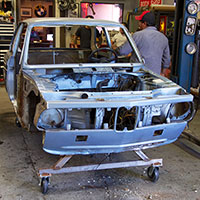 Restoration of the Clarion Builds 1974 BMW 2002 is already underway with a complete tear down as the first task followed by extensive rust repair