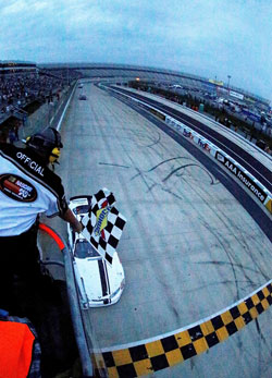 Cory LaJoie takes the checkered flag after having black flag threats during the race at Dover International Speedway