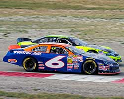 James Bickford, in the number 6 Sunrise Ford of Fontana race car, challenged Greg Pursley on lap 43 of the NASCAR K&N Pro Series West Utah Grand Prix, shortly before Pursley spun out
