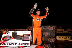 David Mayhew celebrating his NASCAR K&N Pro Series victory at Stockton 150