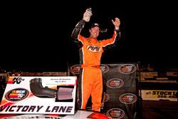 David Mayhew celebrating his NASCAR K&N Pro Series victory at Stockton 150
