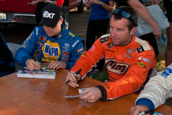 David Mayhews signing autographs before the NASCAR K&N Pro Series race