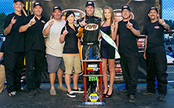 A representative from K&N and Miss Evergreen Speedway presented the MMI Services/Ron's Rear End Chevy race team with a trophy for their NASCAR K&N Pro Series West race win