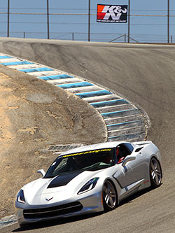 A Hooked On Driving school coach navigates through the infamous Mazda Raceway Laguna Seca corkscrew in their 2014 Chevrolet Corvette Stingray Z51 coupe. Photo by Dito Milian/gotbluemilk.com