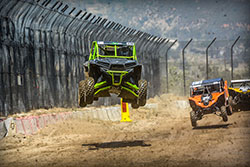Brad Deberti jumps with his Pro Production Polaris RZR at Lucas Oil Off Road Series