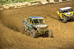 Brad Deberti passing a Yamaha YXZ with his Polaris RZR at Lucas Oil Off Road Series