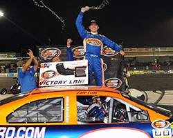Dylan Lupton celebrates the victory on top of his race car