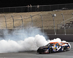 Dylan Lupton celebrates his second NASCAR K&N Pro Series West Race victory by doing a burnout in the number 9 Sunrise Ford of Fontana Fusion on the Kern County Raceway Park infield