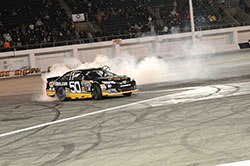 Chris Eggleston does a burnout after winning the NASCAR K&N Pro Series West race at Orange Show Speedway in San Bernardino, California.