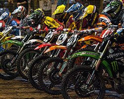 Geico Motorcycle EnduroCross races begin with riders lining up behind a gate, just as they do in Supercross