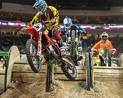 Even unnatural obstacles, such as these wooden spools, are used in an AMA EnduroCross fueled by Monster Energy course