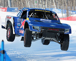 The trucks are equipped with one-off spiked tires specifically made for the Red Bull Frozen Rush