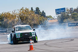 Vaughn Gittin Jr taking spectators for a ride in his Funhaver F-150