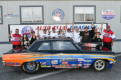 Greg (fourth from right) and crew celebrate the win at Fontana last spring, after going seven rounds to win the Super Street class in the Chevy II he built more than 20 years ago with his father.